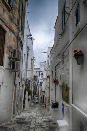 Narrow street of apartment buildings, Ostuni, Puglia, Italy