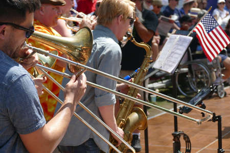 PORTLAND, OREGON - JUL 4, 2019 - Trombones and saxaphone entertain the crowd at the Waterfront Blues Festival, Portland, Oregon 에디토리얼