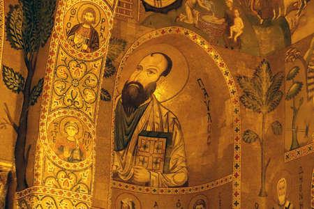 PALERMO, SICILY - NOV 28, 2018 - Mosaics of Saints on  columns and arches and walls  of the Capella Palatina, Palermo, Sicily, Italy