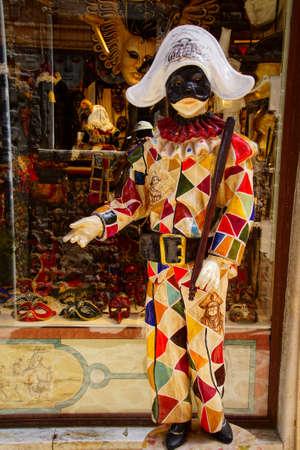 VENICE, ITALY - AUG 10, 2018 - Carnival costume of harlequin, Venice, Italy