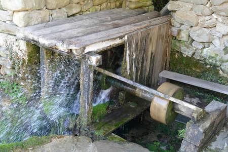 Water wheel powers 19th century light industry in Ethnographic village, Etura, Gabravo, Bulgaria Stock Photo