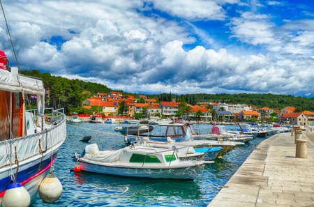 Boats docked in the marina harbor of Stari Grad, Hvar Island, Croatia