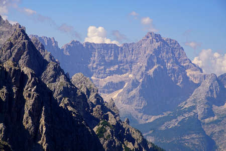 Rows of jagged peaks and green meadows of the Dolomites Alps, Italy 写真素材