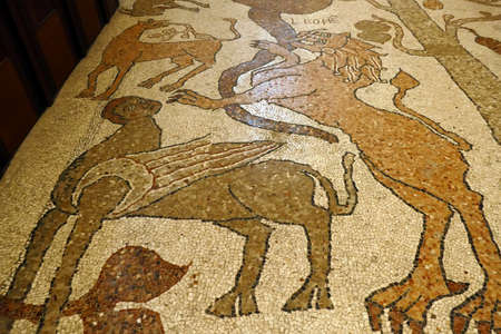 OTRANTO, ITALY - APR 8, 2019 - Beasts and monsters on the mosaic floor of the cathedral in Otranto, Puglia, Italy