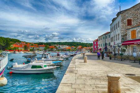 STARI GRAD, CROATIA - APR 30, 2019 -  Boats docked in the marina harbor of Stari Grad, Hvar Island, Croatia