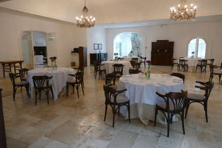 BRINDISI, ITALY - APR 11 2019 - Dining room and lounge built around ancient olive trees at a masseria near Brindisi, Puglia, Italy 에디토리얼