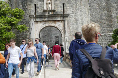 DUBROVNIK, CROATIA - APR 26, 2019 - Tourists at the Pile Gate, the main gate of the city, Dubrovnik, Croatia Editorial