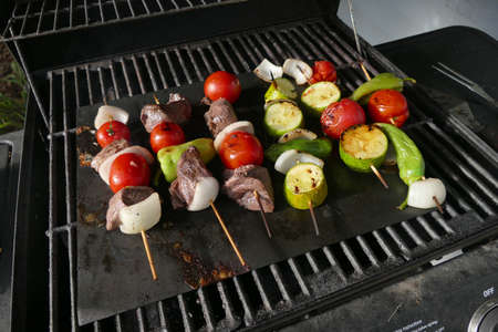 Skewers of lamb, tomato,onion and pepper on the grill, Seattle, Washington