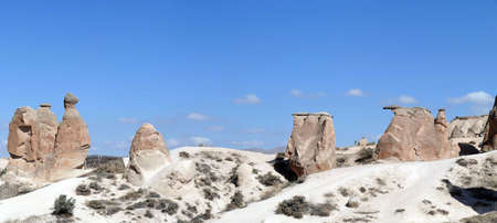 Panorama of fairy chimney balanced rock formations near Devrent, Cappadocia, Turkey 版權商用圖片