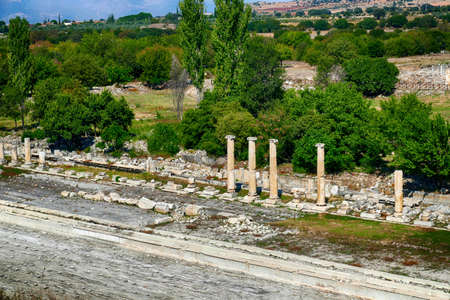 Ionic  columns surround ruins of the gymnasium in Aphrodisias,  Turkey