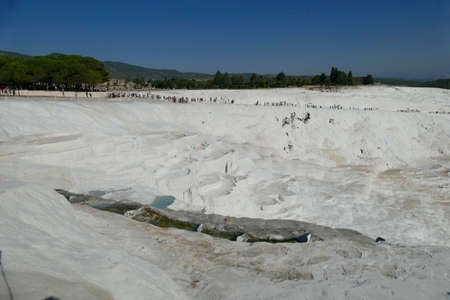 Tourists descend  travertine   terraces at  Pamukkale,  Turkey Stock fotó