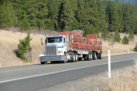 Semi truck and trailer climbing towards Blewett Pass in eastern Washington