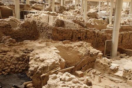 AKROTIRI, SANTORINI - DEC 2, 2018 - Reconstructed mud brick walls of the excavation of the ancient ruins of Akrotiri, Santorini, Greece