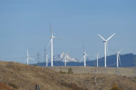 Windmills and power lines  with Mt Stuart in background, eastern Washington
