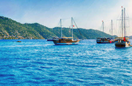 Gulet yachts anchored  in the harbor of Kale, Turkey 스톡 콘텐츠 - 131957068