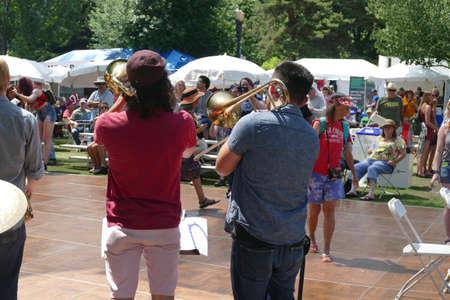 PORTLAND, OREGON - JUL 4, 2019 - Trombone players entertain the crowd at the Waterfront Blues Festival, Portland, Oregon 版權商用圖片