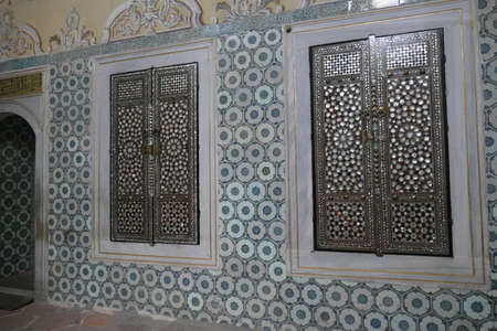 ISTANBUL, TURKEY  - SEP 6, 2019 -  Door with mother of pearl inlays  in the Harem  in Topkapi,  in Istanbul, Turkey