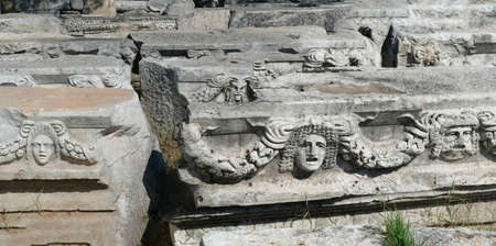 Sculpted Greek masks recovered from the ruins of the theater of  Aphrodisias,  Turkey