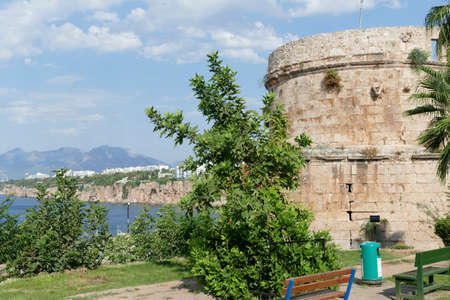 Ancient defensive tower on cliff of Antalya, Turkey