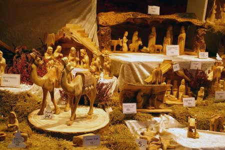 HEIDELBERG, GERMANY - DEC 19, 2018 - Hand carved wooden figures for nativity creche, Christmas market,Heidelberg, Germany