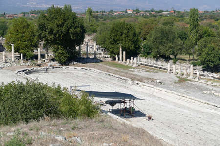 Ionic  columns surround ruins of the gymnasium in Aphrodisias,  Turkey
