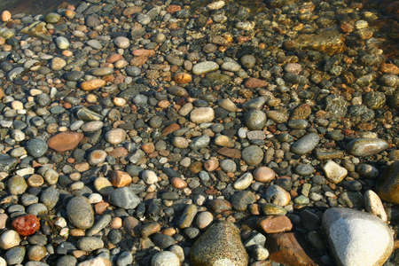 Granite pebbles, rounded by the ocean at Seawall in Acadia National Park, Mount Desert Island, Maine, New England Stock Photo