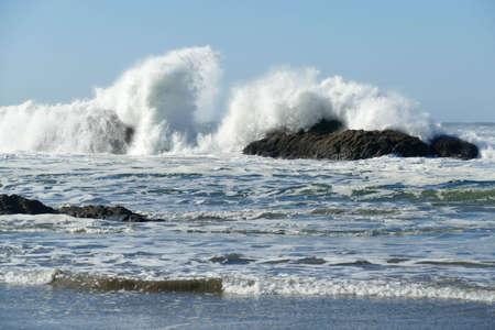 Heavy seas crash on rocks of Seal Rocks State Park near Newport, Oregon