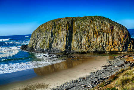 Elephant rock with reflections in incoming tide, Seal Rocks State Park, Newport, Oregon