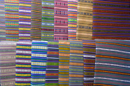 Bright fabrics for sale in a crafts shop in Thimphu, Bhutan