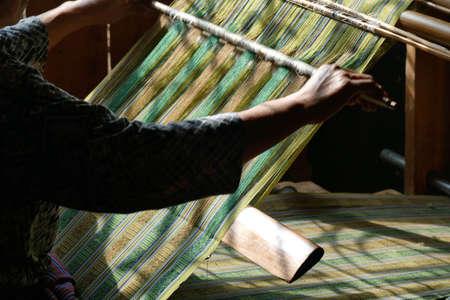 Young woman working a backstrap loom in Thimphu, Bhutan