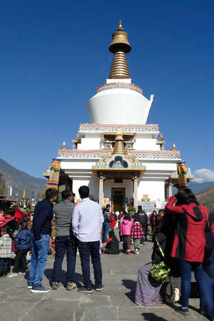 THIMPHU, BHUTAN - DEC 10 2019 - Locals and tourists mingle at the Memorial Chorten dedicated to the third king of BhutanThimphu, Bhutan Editorial
