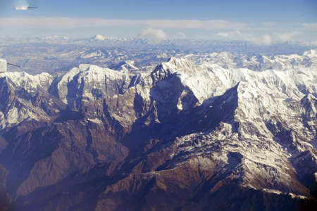 Aerial view of high peaks of the Himalayan mountains of Nepal