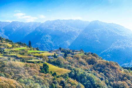 Green terraced rice paddies on steep mountainside near Trongsa, Bhutan Stock fotó