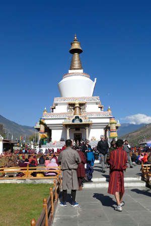 THIMPHU, BHUTAN - DEC 10 2019 - Locals and tourists mingle at the Memorial Chorten dedicated to the third king of BhutanThimphu, Bhutan Sajtókép