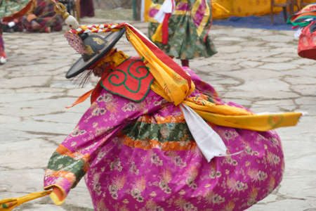 BUMTHANG, BHUTAN - DEC 13, 2019 - Purple skirt Black hat dancers Zhang cham   celebrate victory of good over evil,    Nalakar Tsechu Dance Festival , Ngala Lhakhang Temple Bumthang,  Bhutan