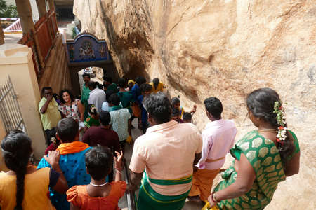 TANJORE, INDIA - DEC 29, 2019 - Pilgrims on the steep stairs leading to the Rock Fort Shiva Temple, Trichy Tiruchirappalli, Tanjore, Tamil Nadu , India Editorial