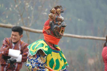 BUMTHANG, BHUTAN - DEC 13, 2019 - Terrifying mask of the Tsholing cham wrathful deities who dance to purify the ground of evil influences,  Nalakar Tsechu Dance Festival , Ngala Lhakhang Temple