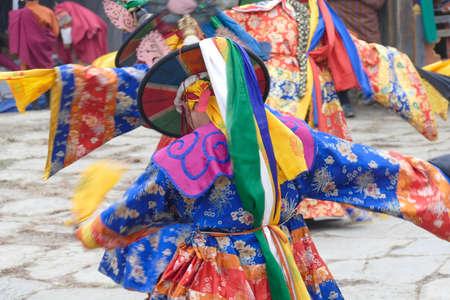 BUMTHANG, BHUTAN - DEC 13, 2019 - Blue skirt Black hat dancers Zhang cham   celebrate victory of good over evil,    Nalakar Tsechu Dance Festival , Ngala Lhakhang Temple Bumthang,  Bhutan