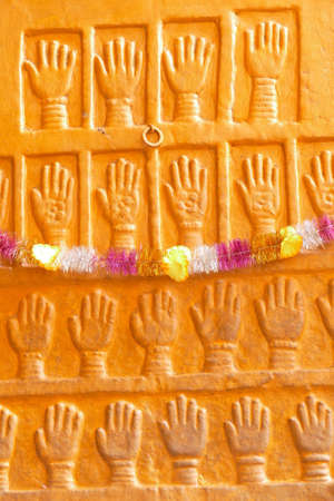 Satee hands memorial to widows who threw themselves on husbands funeral pyre, at the  gate of the Mehrengarh Fort, Jodhpur, Rajasthan, India