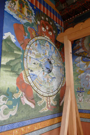 Painted mandala on exterior porch of the Kurjey Lakhang Templ, built around a cave where Guru Rimpoche meditated and left his body imprint Bhutan