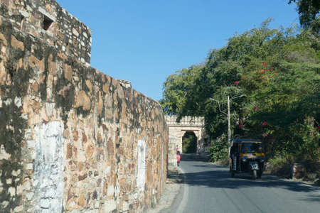 CHITTORGARH, INDIA - JAN 10, 2020 -  Massive gates of  the ancient fort on the steep road  to the fortified city of Chittorgarh, Rajasthan, India