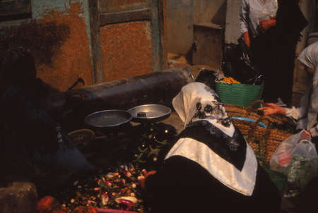 CAIRO, EGYPT - OCT 14, 1996 - Street vendors sell vegetables in Old City of Cairo, Egypt, Middle East
