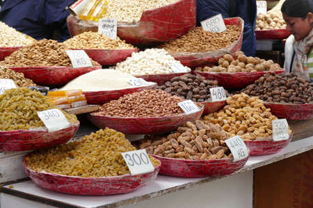 Spices,dried fruit and nuts displayed on street shop in Old Delhi, India