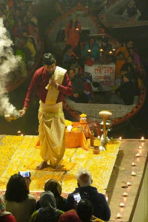 VARANASI, INDIA - DEC 22,  2019 - Brahmin priests conduct  the aarti evening prayer service at the Dashashwamedh Ghat in Varanasi, India