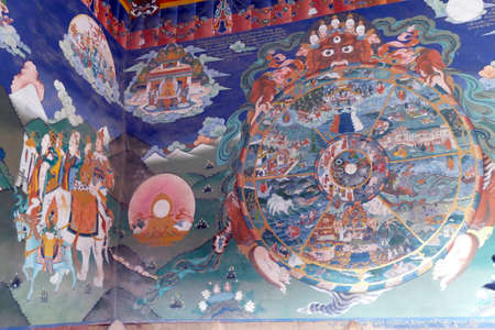 TRONGSA, BHUTAN - DEC 14, 2019 - Lord Yama holds  mandala of the circle of life and death, Trongsa Dzong  fortress, Trongsa,  Bhutan