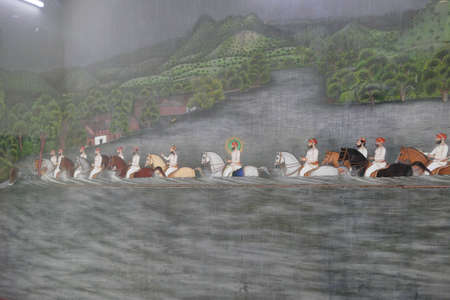 UDAIPUR, INDIA - JAN 7,2020 - Maharana Feteh Singh crossing a river on horseback, miniature painting from 1893, City Palace, Udaipur, Rajasthan, India
