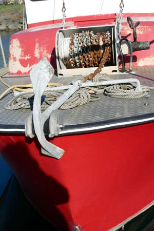 Block and tackle for rigging and anchor on fishing boat in the Yaquina marina,  Newport, Oregon 報道画像