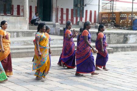 CHITAMBARAM, INDIA - DEC 28, 2019 - Women pilgrims in colorful sarees in the   Shiva Nataraja temple from 12th century in Chitambaram, Tamil Nadu , India