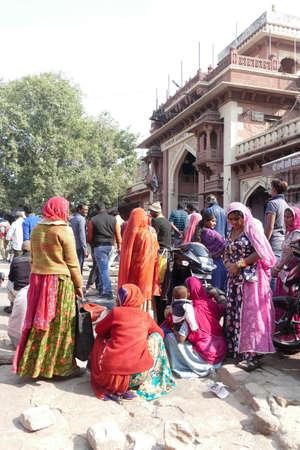 JODHPUR, INDIA - JAN 4, 2020 - Bright colored sarees of women at the Ghanta Ghar, the Clock Tower market of Jodhpur, Rajasthan, India