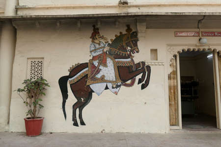 UDAIPUR, INDIA - JAN 7,2020 - Caparisoned horse painting on courtyard wall of the City Palace, Udaipur, Rajasthan, India 報道画像